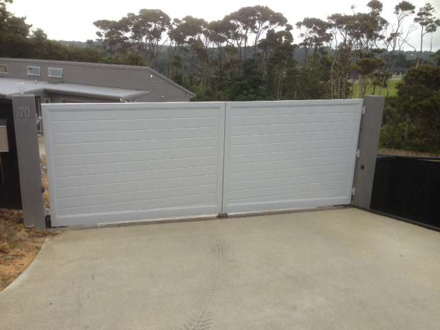 Horizontal tongue and groove - Double Swing gates - in this case also with a sloping bottom to match slope across the driveway