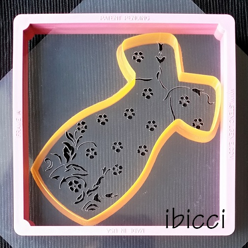 ibicci Lace Dress stencil in a Genie Frame with cutter underneath