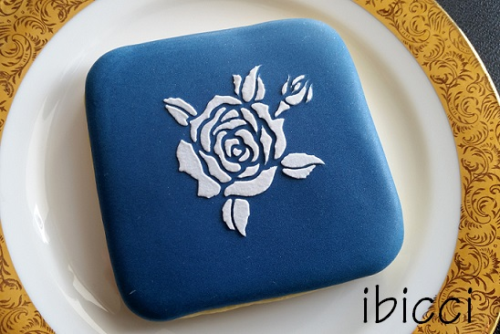 White rose on blue background cookie using the ibicci Rose with bud stencil
