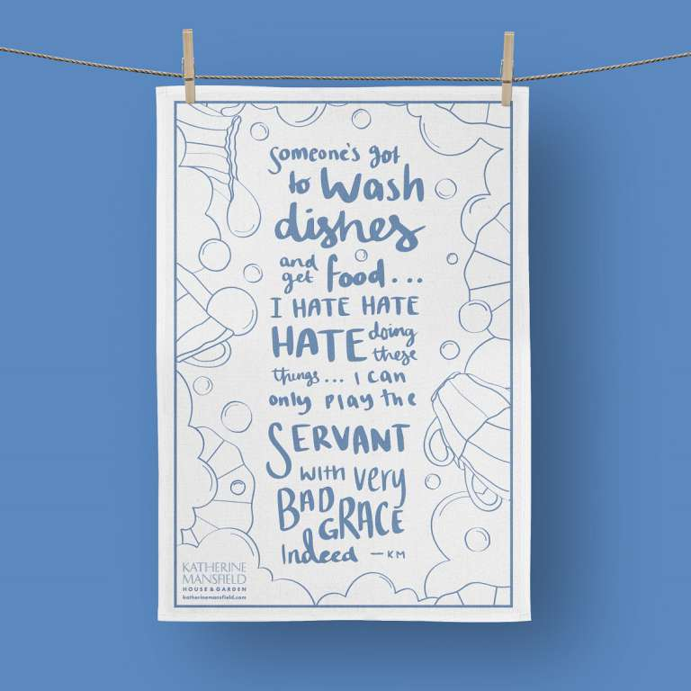 KMHG quote tea towel hanging on a line with wooden pegs
